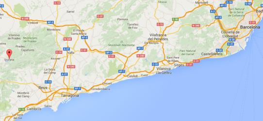 Fly til Barcelona, kjøre bil ca 90 minutter.